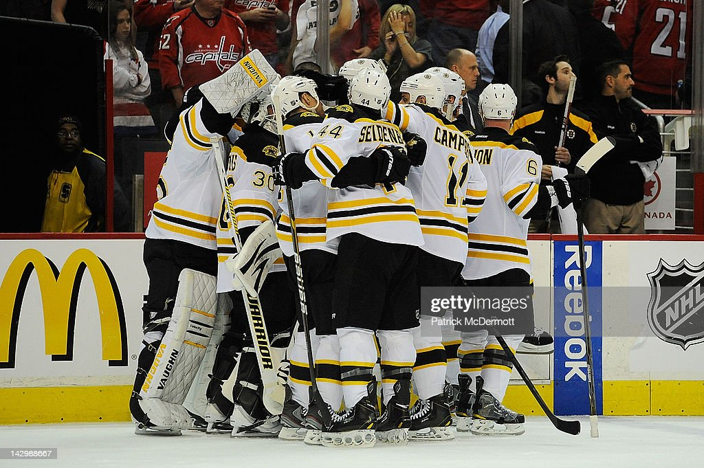 The Boston Bruins celebrate after defeating the Washington Capitals in Game Three of the Eastern Conference Quarterfinals during the 2012 NHL Stanley Cup Playoffs at Verizon Center on April 16, 2012 in Washington, DC.