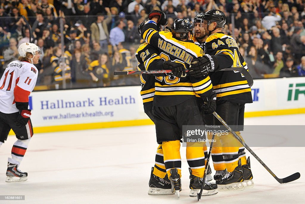 The Boston Bruins celebrate an over time win against the Ottawa Senators at the TD Garden on February 28, 2013 in Boston, Massachusetts.