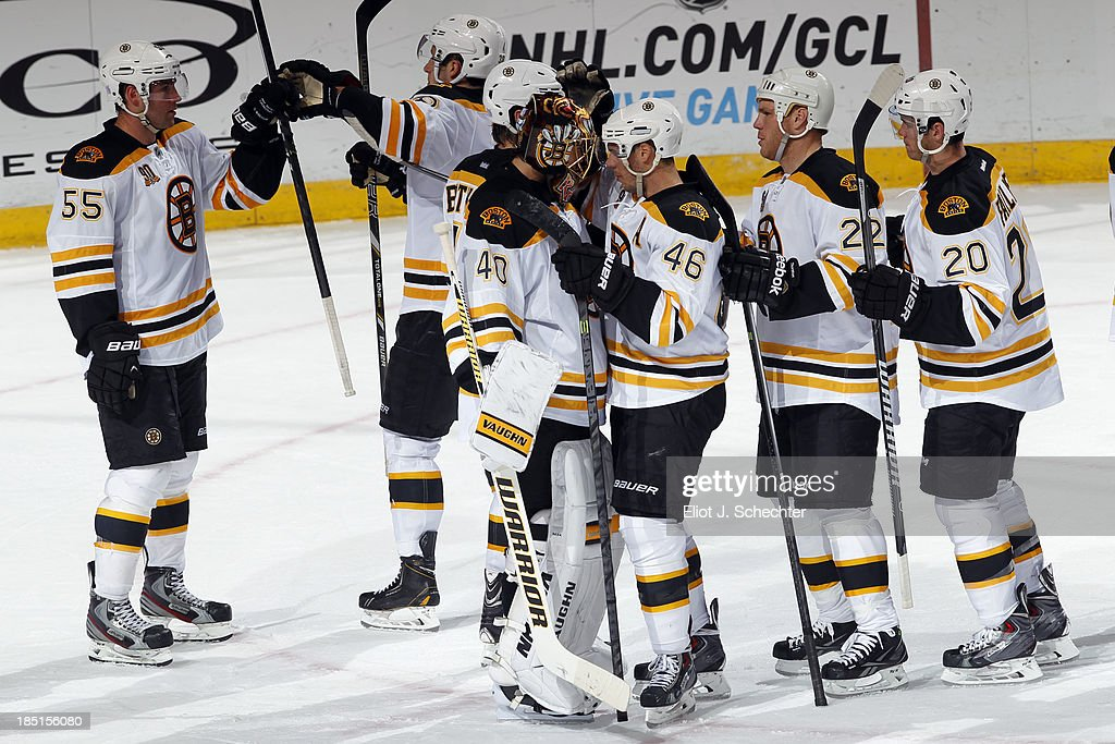 The Boston Bruins celebrate their 3-2 win over the Florida Panthers at the BB&T Center on October 17, 2013 in Sunrise, Florida.