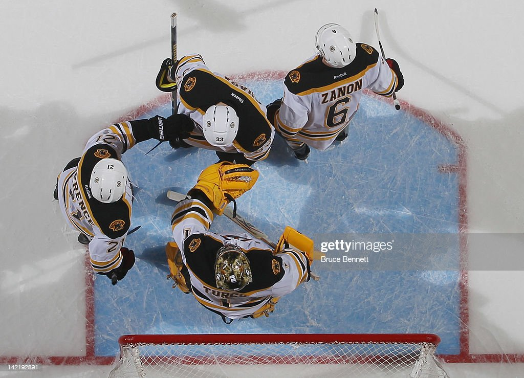 The Boston Bruins celebrate their 6-3 victory over the New York Islanders at the Nassau Veterans Memorial Coliseum on March 31, 2012 in Uniondale, New York.