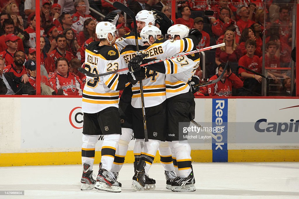 The Boston Bruins celebrate their fourth and game winning goal during the third period of Game Three of the Eastern Conference Quarterfinals of the 2012 NHL Stanley Cup Playoffs against the Washington Capitals on April 16, 2012 at the Verizon Center in Washington, DC.