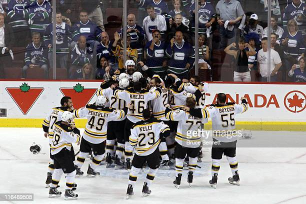 The Boston Bruins celebrates after defeating the Vancouver Canucks in Game Seven of the 2011 NHL Stanley Cup Final at Rogers Arena on June 15 2011 in...