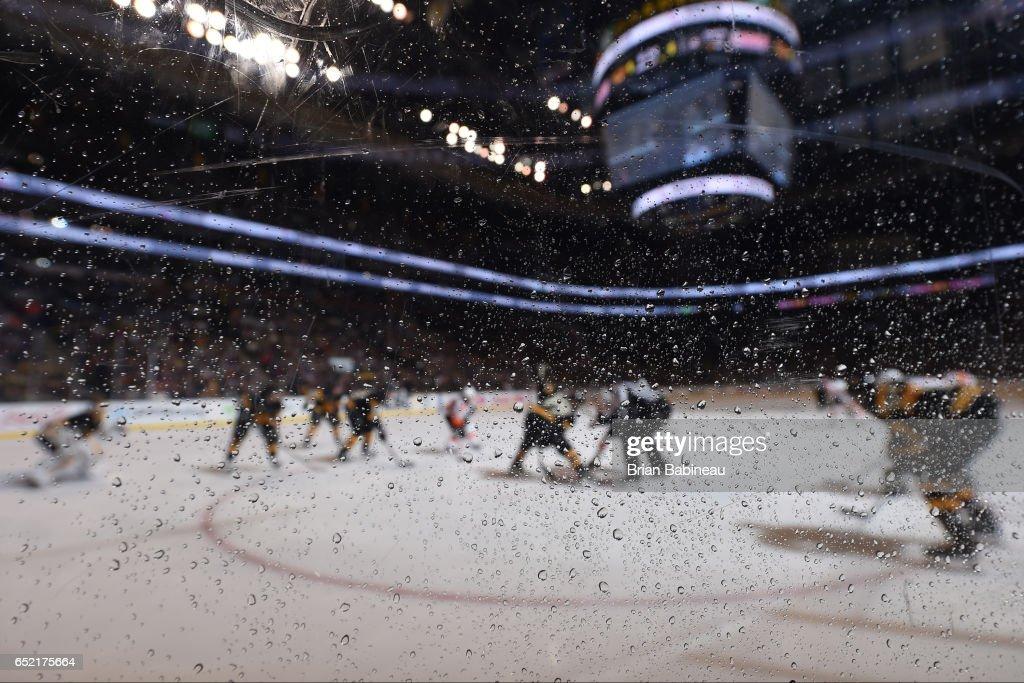 The Boston Bruins face off against the Philadelphia Flyers at the TD Garden on March 11, 2017 in Boston, Massachusetts.
