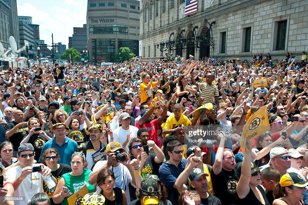 The Boston Bruins fans celebrate the Stanley Cup victory during rolling rally in front of the Boston Public Library in Copley Square Boston MA on...