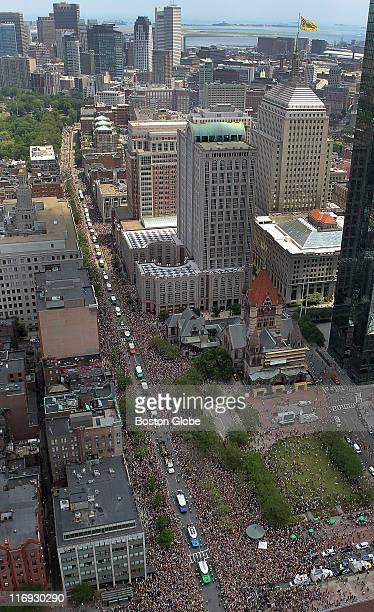 The Boston Bruins parade through the streets of Boston with the Stanley Cup
