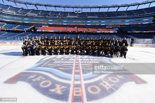 The Boston Bruins pose for a team photo prior to their team practice as part of the 2016 Bridgestone NHL Classic at Gillette Stadium on December 31...