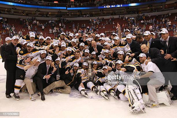 The Boston Bruins pose for the traditional team photo with the Stanley Cup The Boston Bruins took on the Vancouver Canucks in Game 7 of the NHL...