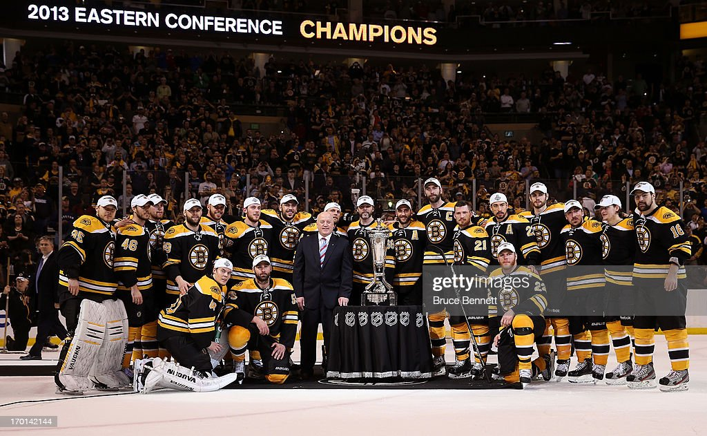 The Boston Bruins pose with the Prince of Wales Trophy after defeating the Pittsburgh Penguins 1-0 in Game Four of the Eastern Conference Final during the 2013 NHL Stanley Cup Playoffs at the TD Garden on June 7, 2013 in Boston, United States.