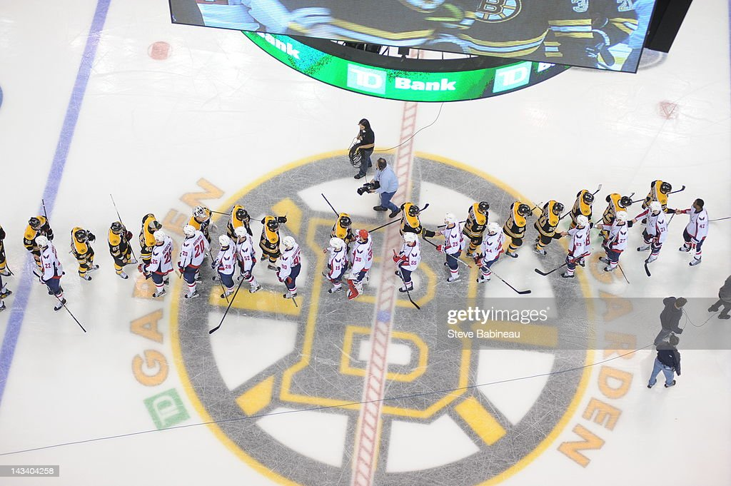 The Boston Bruins shake hands with the Washington Capitals after the loss on home ice in Game Seven of the Eastern Conference Quarterfinals during the 2012 NHL Stanley Cup Playoffs at TD Garden on April 25, 2012 in Boston, Massachusetts.