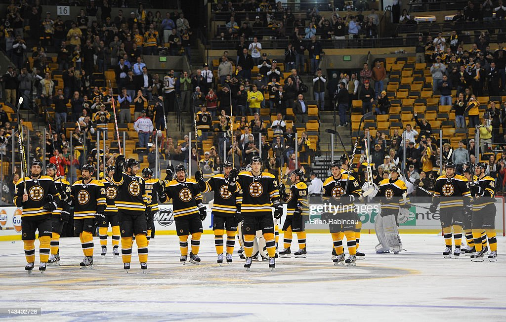 The Boston Bruins wave to the fans after the loss against the Washington Capitals in Game Seven of the Eastern Conference Quarterfinals during the 2012 NHL Stanley Cup Playoffs at TD Garden on April 25, 2012 in Boston, Massachusetts.