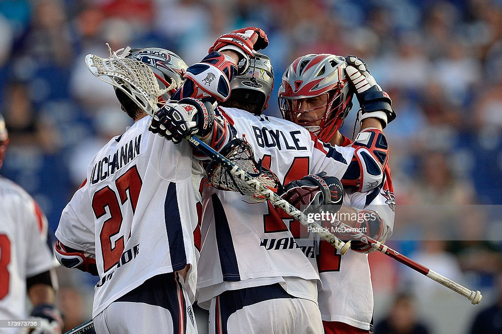 The Boston Cannons celebrate after Ryan Boyle #14 scored a goal in the first half during a game against the Chesapeake Bayhawks at Navy-Marine Corps Memorial Stadium on July 18, 2013 in Annapolis, Maryland.