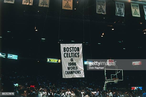The Boston Celtics 1986 Championship banner is raised to the rafters during the Celtics 1986 Championship ring ceremony prior to their home opener...