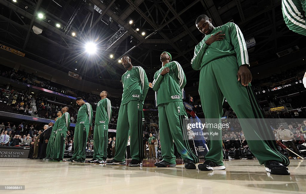 The Boston Celtics bow theirs heads during the singing of the National Anthem prior to the game against the Cleveland Cavaliers at The Quicken Loans Arena on January 22, 2013 in Cleveland, Ohio.