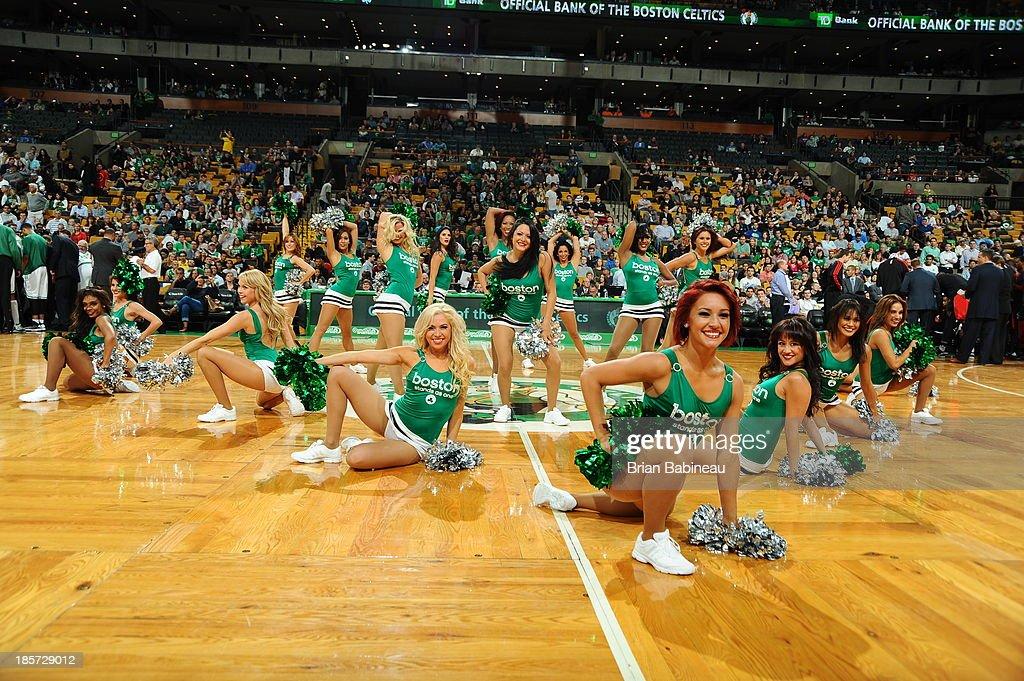 The Boston Celtics dance team performs during the game against the Toronto Raptors during the game against the Toronto Raptors on October 7, 2013 at the TD Garden in Boston, Massachusetts.