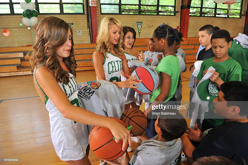 The Boston Celtics dancers sign autographs during the unveiling of the Learn & Play Center at the Boston Centers for Youth & Families (BCYF) Tobin Community Center on June 9, 2010 in Boston, Massachusetts.