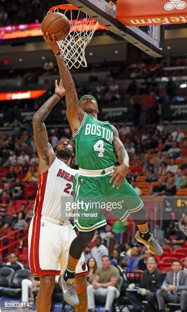 The Boston Celtics' Isaiah Thomas scores against the Miami Heat's Derrick Williams on November 28 at the AmericanAirlines Arena in Miami Now with the...