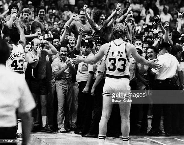 The Boston Celtics' Larry Bird asks fans to push back during playoff game 7 against the Los Angeles Lakers at Boston Garden on June 12 1984
