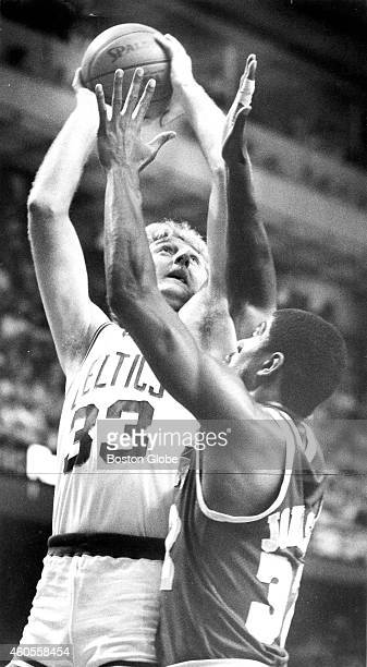 The Boston Celtics' Larry Bird attempts a shot over the head of Los Angeles Lakers' Magic Johnson during Game 1 of the NBA Finals