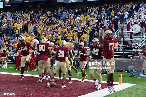 The Boston College Eagles celebrate a touchdown against the Virginia Tech Hokies in the second half at Alumni Stadium The Eagles won the game 34 to...