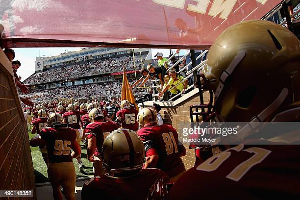 The Boston College Eagles enter the field before their game against the Northern Illinois Huskies at Alumni Stadium on September 26 2015 in Chestnut...