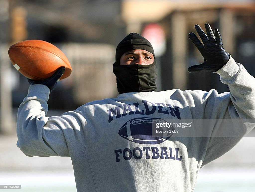 The Boston Freedom Fighters football team held a practice at MacDonald Stadium in Malden. Junior St. Surin throws a pass. He lives in Malden and played for Malden High School.