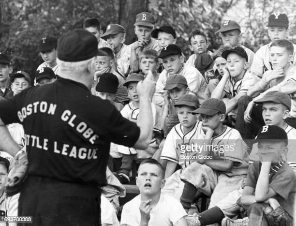 The Boston Globe Little League Director Artie Gore holds a questionandanswer period during a little league clinic in Ipswich Mass June 16 1960