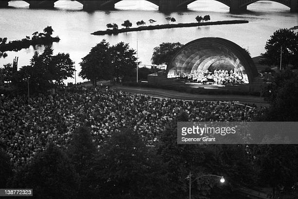 The Boston Pops Orchestra performs at the Hatch Memorial Band Shell on the Charles River Embankment Boston Massachusetts 1972