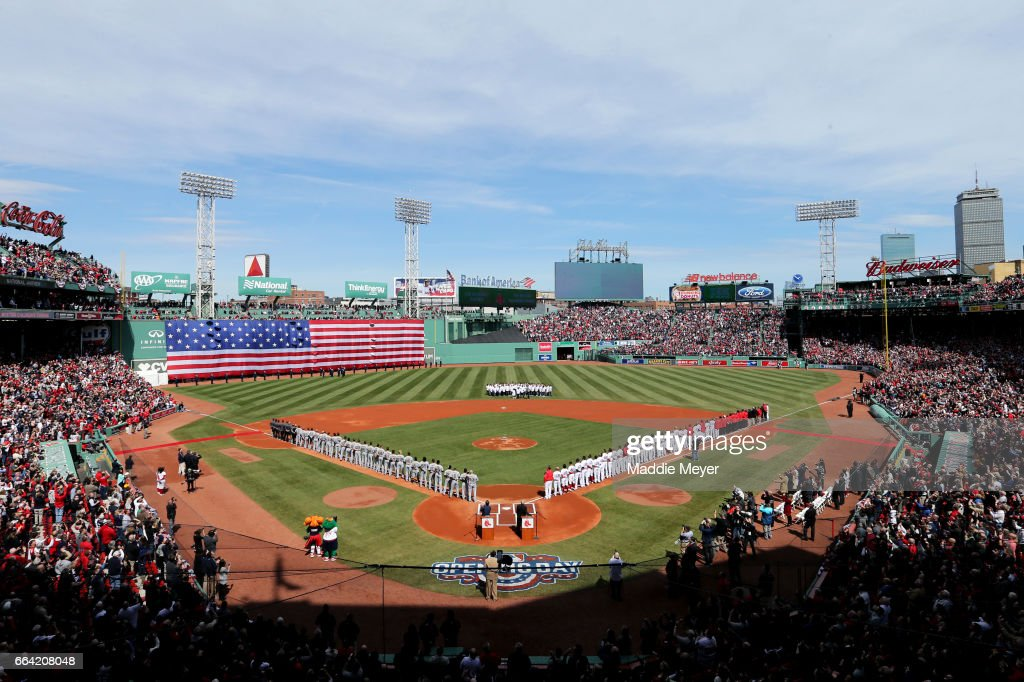 The Boston Red Sox and the Pittsburgh Pirates lineup for the national anthem before the opening day game at Fenway Park on April 3, 2017 in Boston, Massachusetts.