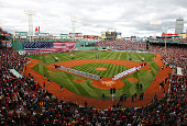 The Boston Red Sox and the Tampa Bay Rays line the field before their opening day game at Fenway Park April 7 2009 in Boston Massachusetts