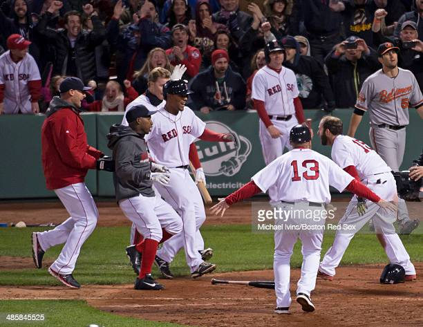The Boston Red Sox celebrate a 65 victory over the Baltimore Orioles after Dustin Pedroia scored on a throwing error in the ninth inning at Fenway...