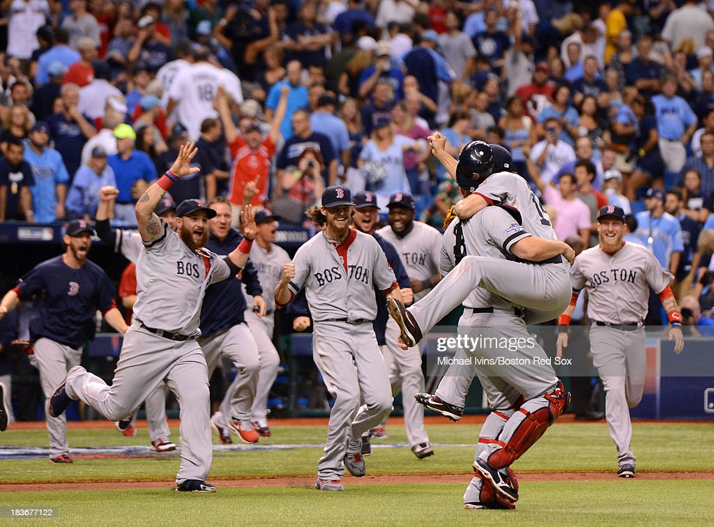 The Boston Red Sox celebrate a win against the Tampa Bay Rays during the first inning of Game Four of the American League Division Series on October 8, 2013 at Tropicana Field in St. Petersburg, Florida.