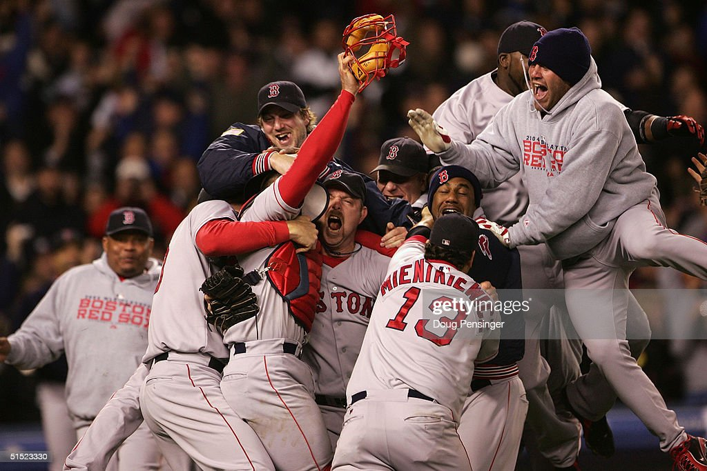 The Boston Red Sox celebrate after defeating the New York Yankees 103 in game seven of the American League Championship Series on October 20 2004 at...