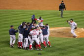 The Boston Red Sox celebrate after defeating the New York Yankees 103 to win game seven of the American League Championship Series on October 20 2004...