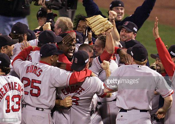 The Boston Red Sox celebrate after defeating the St Louis Cardinals in game four of the World Series 30 to win the World Series on October 27 2004 at...