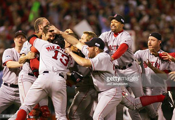 The Boston Red Sox celebrate after defeating the St Louis Cardinals 30 in game four of the World Series on October 27 2004 at Busch Stadium in St...