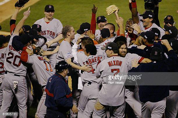 The Boston Red Sox celebrate after winning game four of the 2004 World Series against the St Louis Cardinals at Busch Stadium on October 27 2004 in...