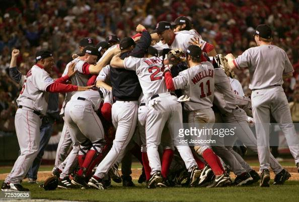 The Boston Red Sox celebrate on the field after defeating the St Louis Cardinals 30 in game four of the World Series on October 27 2004 at Busch...