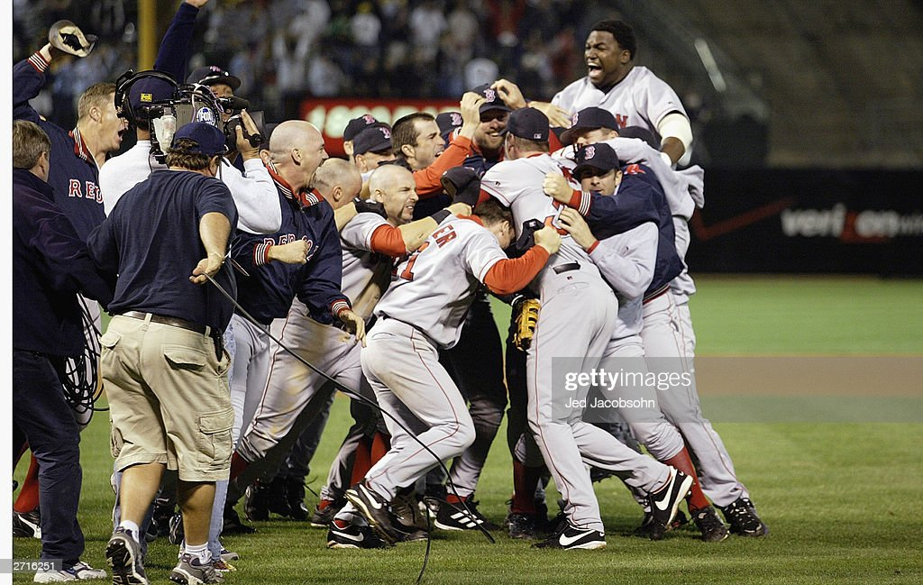 The Boston Red Sox celebrate the victory over the Oakland A's in game 5 of the 2003 American League Divisional Series at the Network Associates Coliseum on October 6, 2003 in Oakland, California. The Red Sox defeated the A's 4-3.