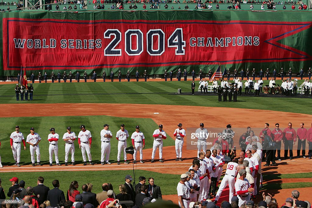 The Boston Red Sox celebrate their 2004 World Series Championship during a pregame ceremony prior to the game against the New York Yankees at Fenway...