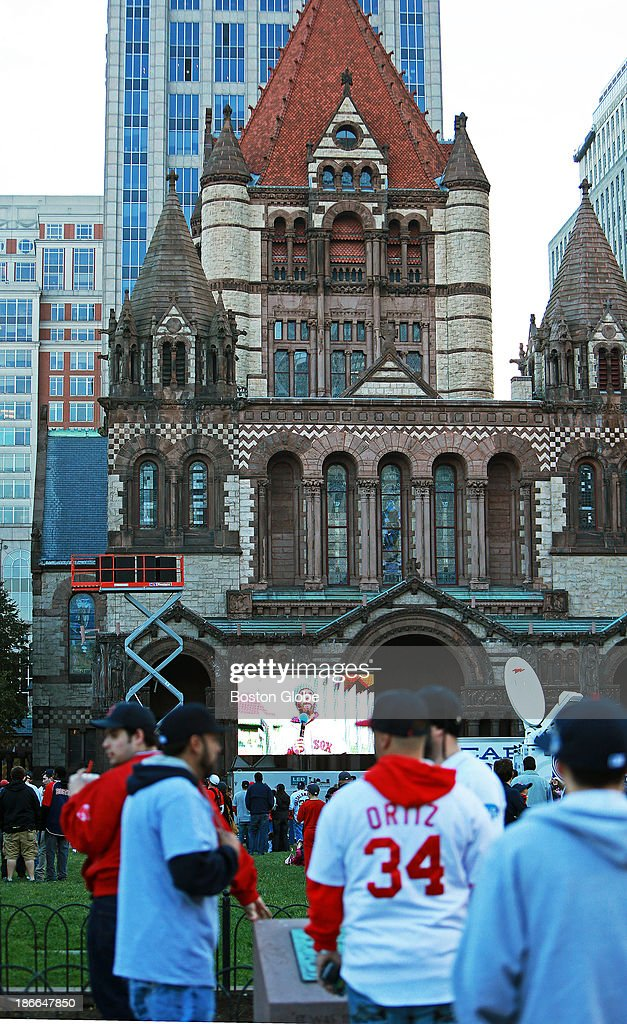 The Boston Red Sox celebrate their World Series victory with a Rolling Rally duck boat parade on Saturday, Nov. 2, 2013. A giant television screen was set up in Copley Square, and before the parade started, the Red Sox's Dustin Pedroia was shown as he spoke at Fenway Park.
