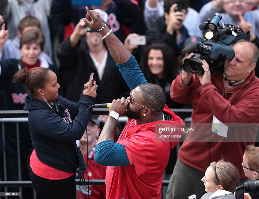 The Boston Red Sox celebrate their World Series victory with a Rolling Rally duck boat parade on Saturday, Nov. 2, 2013. David Ortiz speaks on a microphone as he passes the Boston Public Library and the Boston Marathon finish line on a flatbed truck.
