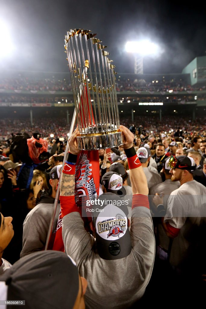 The Boston Red Sox celebrate with the trophy after defeating the St. Louis Cardinals 6-1 in Game Six of the 2013 World Series at Fenway Park on October 30, 2013 in Boston, Massachusetts.