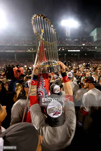 The Boston Red Sox celebrate with the trophy after defeating the St Louis Cardinals 61 in Game Six of the 2013 World Series at Fenway Park on October...