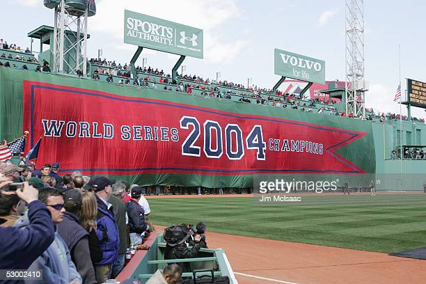 The Boston Red Sox display a 2004 World Series Championship banner during the pregame ceremony celebrating the Red Sox win in the World Series The...