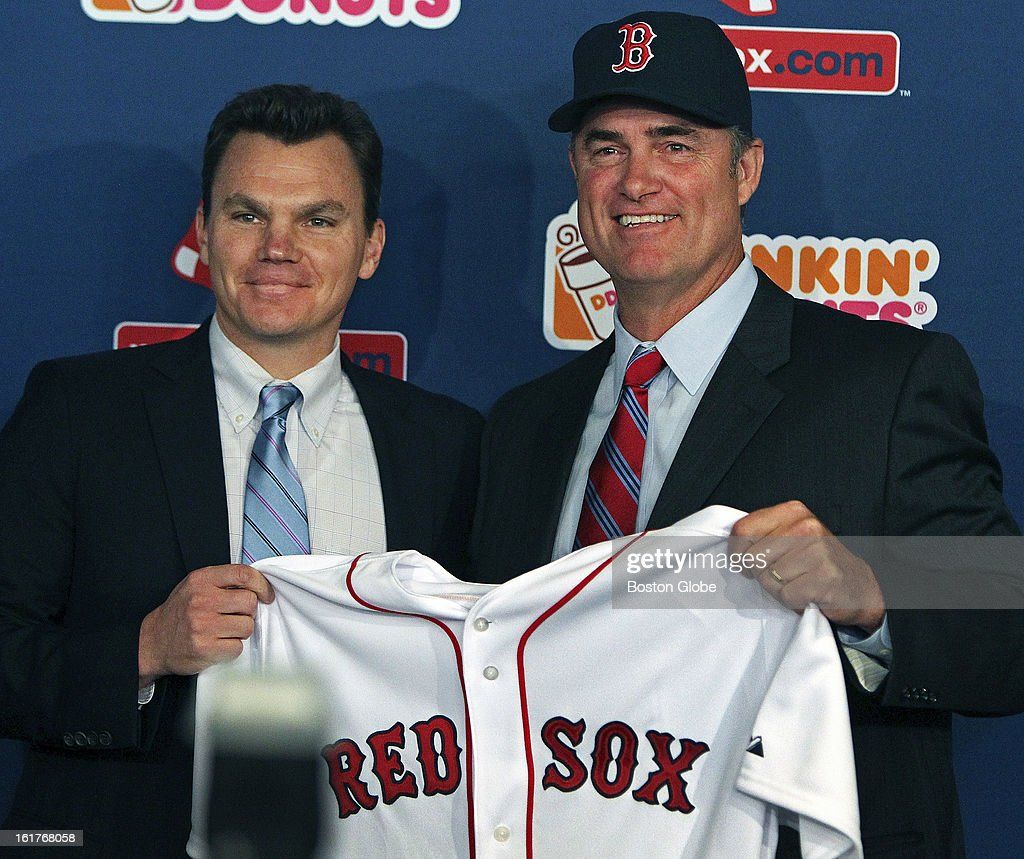 The Boston Red Sox introduced new manager John Farrell, right, at a noon press conference at Fenway Park. Here he poses with general manager Ben Cherington, left, with his hat and jersey.