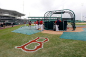 The Boston Red Sox take batting practice just before the start of the Grapefruit League Spring Training Game against the Pittsburgh Pirates at...