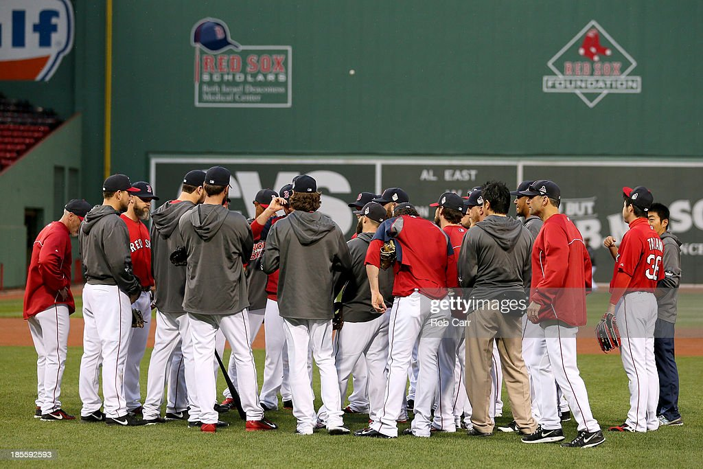 The Boston Red Sox talk in the outfield during team workout in the 2013 World Series Media Day at Fenway Park on October 22, 2013 in Boston, Massachusetts. The Red Sox host the Cardinals in Game 1 on October 23, 2013.