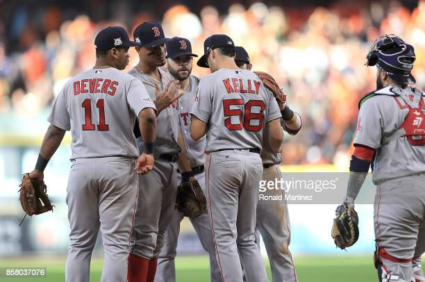 The Boston Red Sox talk to Joe Kelly of after loading the bases in the sixth inning against the Houston Astros during game one of the American League...