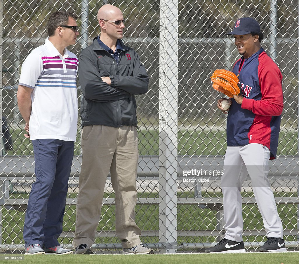 The Boston Red Sox's Ben Cherington, general manager, left, Ben Crockett, director of player development, center, and Pedro Martinez, special assistant to the general manager, right, chat during spring training at JetBlue Park on Tuesday, Feb. 19, 2013.
