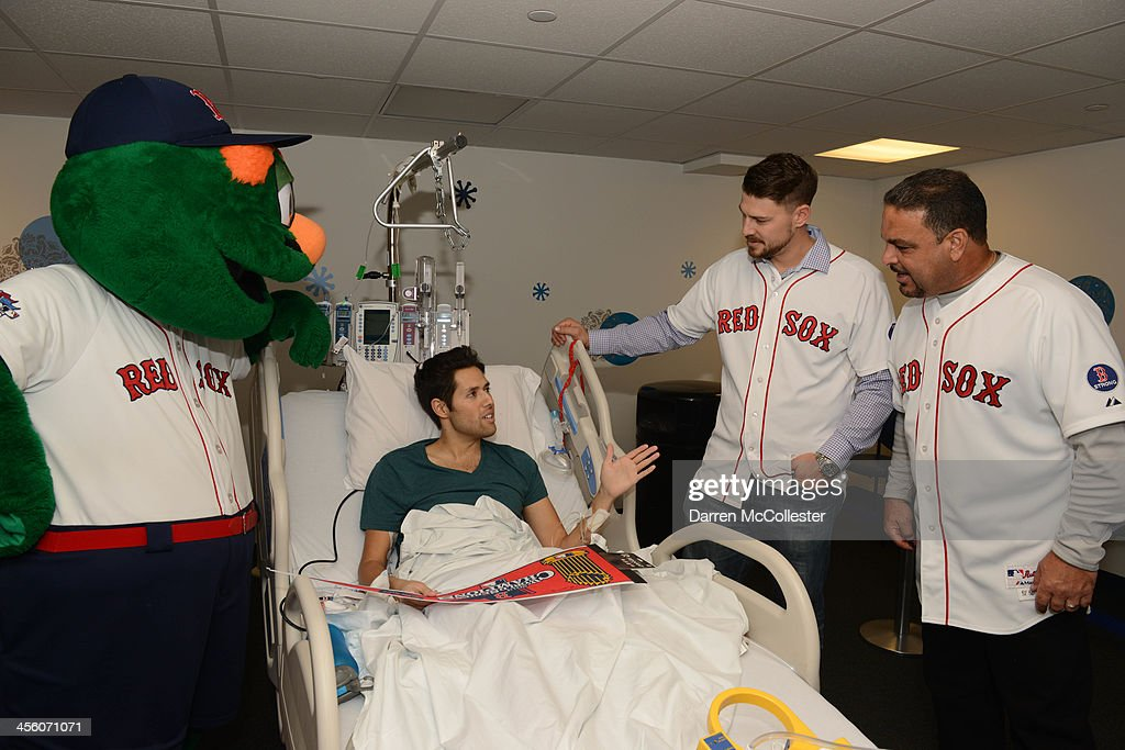 The Boston Red Sox's Wally The Green Monster, Ryan Lavarnway and assistant hitting coach Victor Rodriguez visit Rodrigo at Boston Children's Hospital on December 13, 2013 in Boston, Massachusetts.